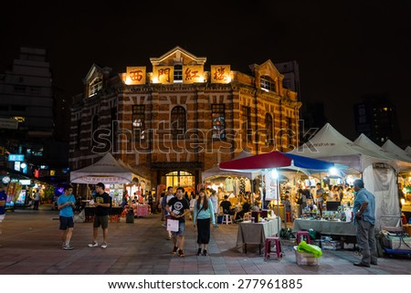 TAIPEI, TAIWAN - May 2: The Red House in Ximending of Taipei at night time with weekend art market which is the gathering place for young artists and creatives on May 2, 2015 in Taipei, Taiwan. - stock photo