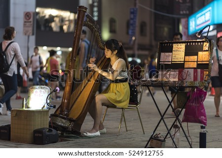 Taipei, Taiwan - November 12th 2016 - Locals and tourists enjoying the street market of Taipei downtown in Taiwan, Asia