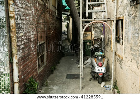 Taipei/Taiwan - October 01 2013: A motorbike is park behind a quite lane.