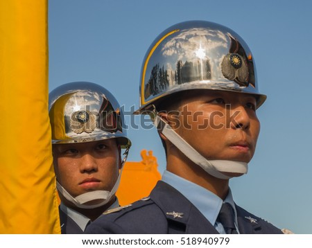 Taipei, Taiwan - October 02, 2016: Soldier wearing shining helmet with a  reflection of the building National Theatre on it