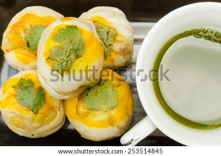 Taiwan delicious dessert - Egg yolk shortcake with a cup of green-tea. - stock photo