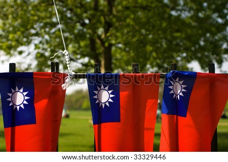Taiwanese flags against a park background - stock photo