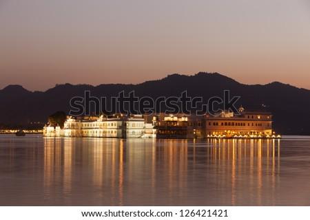 Taj lake palace at night - Udaipur, India - stock photo