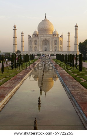 Taj Mahal at sunrise. - stock photo