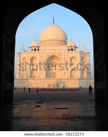 Taj Mahal at sunrise. Some people (not possible to identify) - stock photo