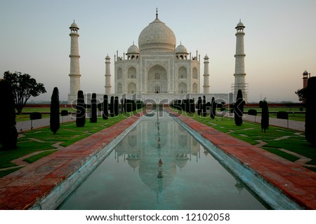 Taj Mahal at sunrise with no people in foreground, Agra, India - stock photo
