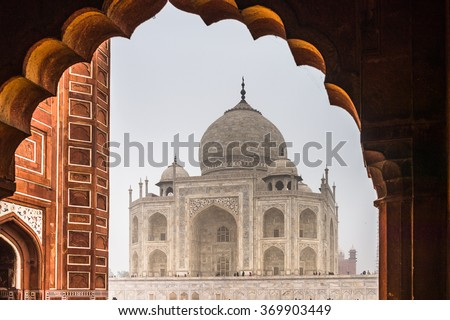 Taj Mahal (Crown of Palaces), an ivory-white marble mausoleum on the south bank of the Yamuna river in Agra. - stock photo