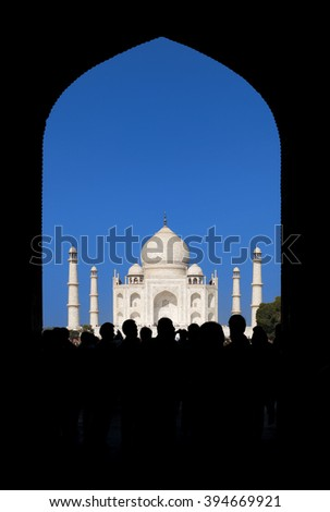 Taj Mahal in the morning. Through the arch frame view. - stock photo
