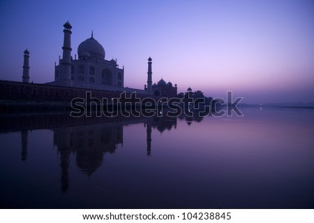 Taj Mahal in twilight view, water reflection of yamuna river - stock photo