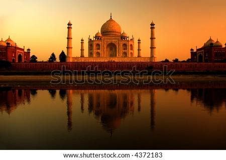 taj mahal, landmark of agra in india during a beautiful orange sunset - stock photo