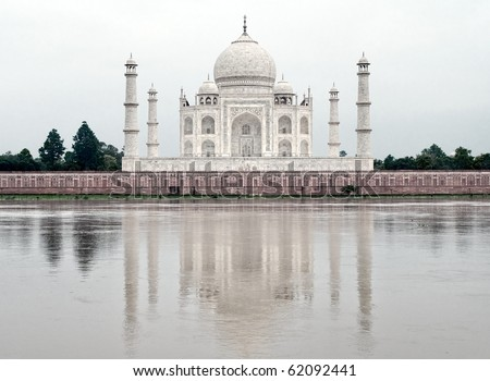Taj Mahal mausoleum in Agra, India, in white early morning light - stock photo