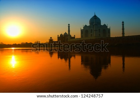 Taj Mahal sunrise reflection in River with blue sky