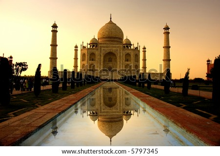taj mahal sunset with reflection - stock photo