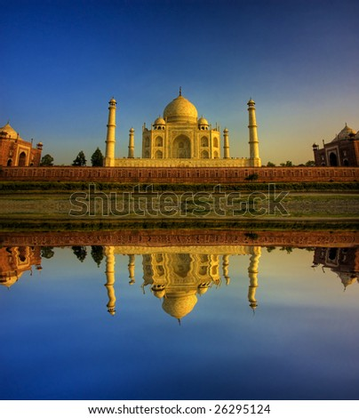 taj mahal with blue sky during sunset - stock photo
