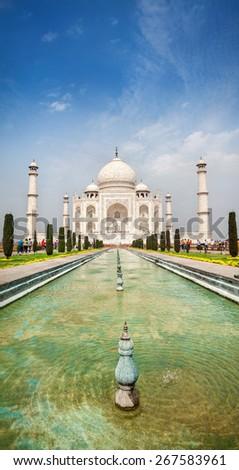 Taj Mahal with fountain at blue sky in Agra, Uttar Pradesh, India - stock photo