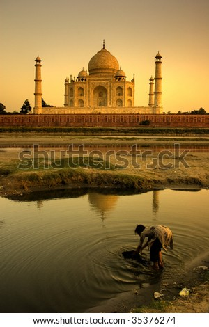 taj mahal, with silhouette of a girl washing clothes - stock photo