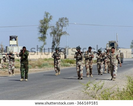 TAJI, IRAQ - SEPTEMBER 24, 2007: Iraqi army soldiers in training - stock photo
