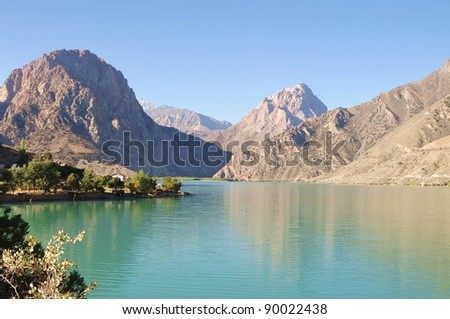 Tajikistan adventure  travels: Iskanderkul Lake - stock photo