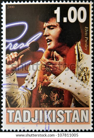 TAJIKISTAN - CIRCA 2000: A stamp printed in Tajikistan shows Elvis Presley, circa 2000 - stock photo