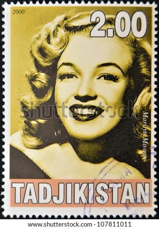 TAJIKISTAN - CIRCA 2000: A stamp printed in Tajikistan shows Marilyn Monroe, circa 2000 - stock photo