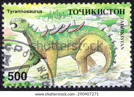 "TAJIKISTAN - CIRCA 1982: a stamp printed in the Tajikistan shows a series of images of ""prehistoric giant dinosaurs"", circa 1982"