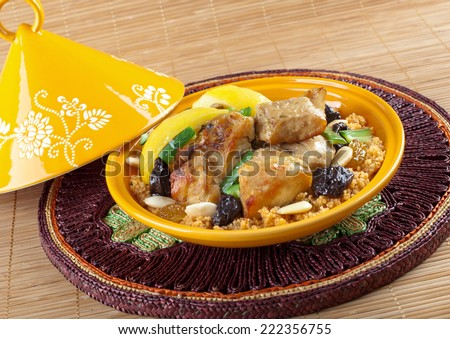 Tajine, moroccan chicken with lemon confit and cous cous. - stock photo