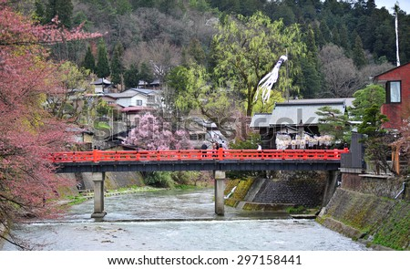 TAKAYAMA, JAPAN - APRIL 12 : Landmark of Takayama, red bridge taken April 12, 2010. Takayama is old town which is register as world heritage site. - stock photo