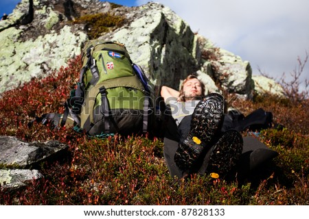 Take a break at hiking tour in autumn in norway - stock photo