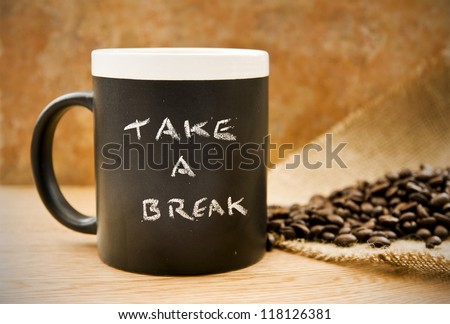 take a break, coffee mug with coffee beans & hessian on counter