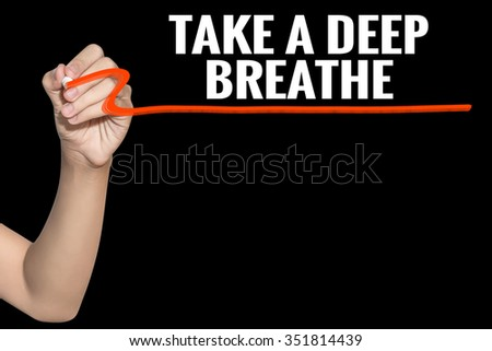 Take a Deep Breathe word write on black background by woman hand holding highlighter pen - stock photo