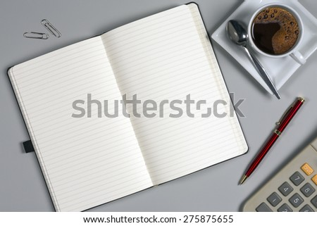 Take a memo - Notepad and coffee cup on an office worktop. - stock photo