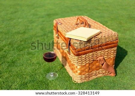 Take a rest. Close up of basket standing on the grass - stock photo