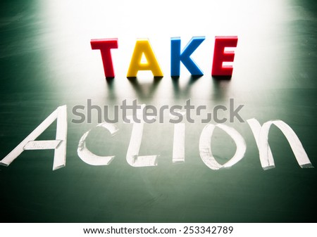 Take action concept, conceptual words on blackboard