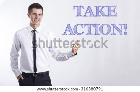 TAKE ACTION! - Young smiling businessman pointing on text