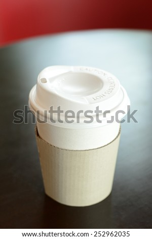 Take away coffee cup on the table - soft focus - stock photo
