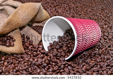 Take away coffee cup with roasted coffee background - stock photo