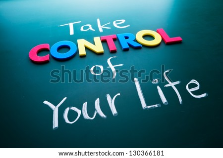 Take control of your life concept, colorful words on blackboard