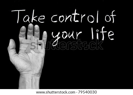 Take control of your life. Words and human hand  on blackboard. - stock photo