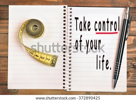 Take control of your life words on notebook