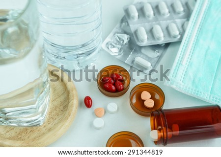Take Medicine Pills for Treatment, Pills and water ready to eat for treatment sickness - stock photo