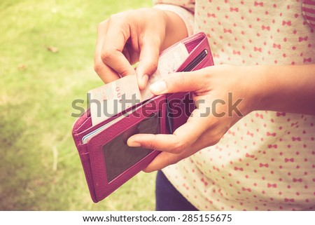 take money from the wallet with filter effect retro vintage style - stock photo