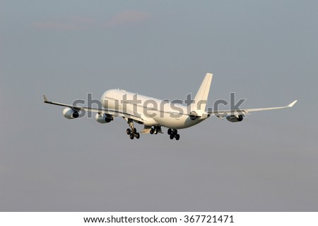 Take off the big white plane in the gray sky - stock photo