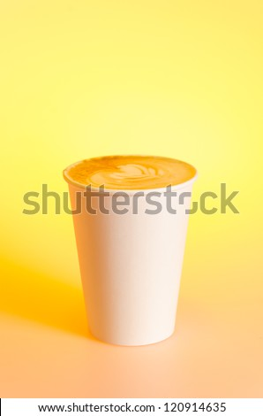 Take-out cappuccino in cardboard cup - stock photo
