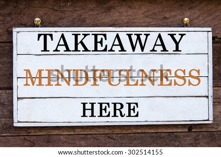 Takeaway Mindfulness Here Inspirational message written on vintage wooden board. Motivation concept image