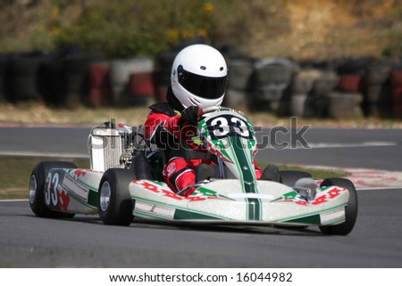 Taken at Camberley Kart, also called Blackbushe, in Hampshire, England.  A novice Minimax formula go kart coming into the chicane. - stock photo