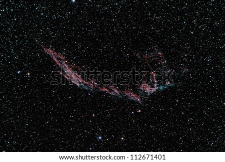 taken by telescope, this one is named veil nebula is a cloud of ionized gas, located in the constellation Cygnus. It is a great example that what remains after a star explosion (supernova) - stock photo