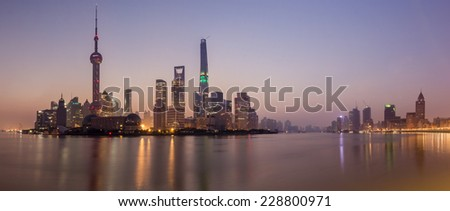 Taken from Huangpu Park on The Bund at sunrise, this was one of the clearest mornings of the year. This panorama of iconic modern Shanghai includes; Pearl Tower, Conference Centre and Shanghai Tower. - stock photo