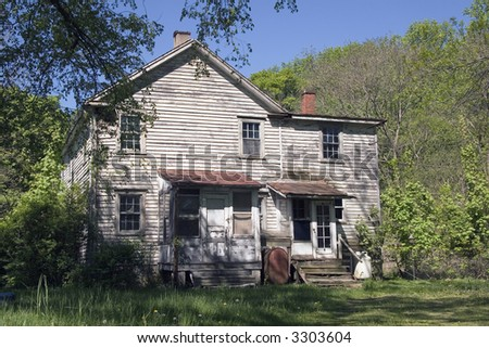 taken in a remote, rural, setting, this home needs some fixing up - stock photo