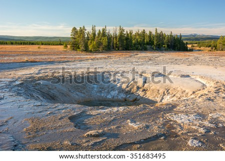 Taken in September 2015, the beautiful turquoise Opal Pool in the Midway Geyser Basin is nearly completely dried up. - stock photo