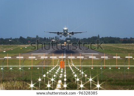 Takeoff of the jet passenger plane - stock photo
